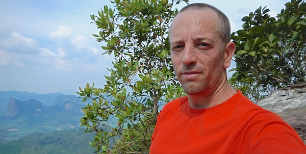 Author Vern Lovic at mountain top in Krabi, Thailand.