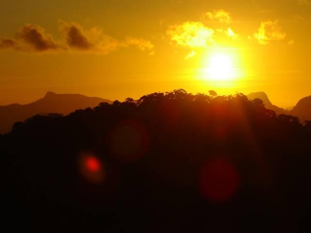 A headless Buddha as the sun sets in Thailand.
