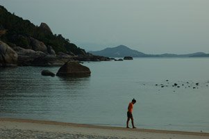 Girl walking at sunrise in meditation on the island of Koh Samui in Thailand's south.