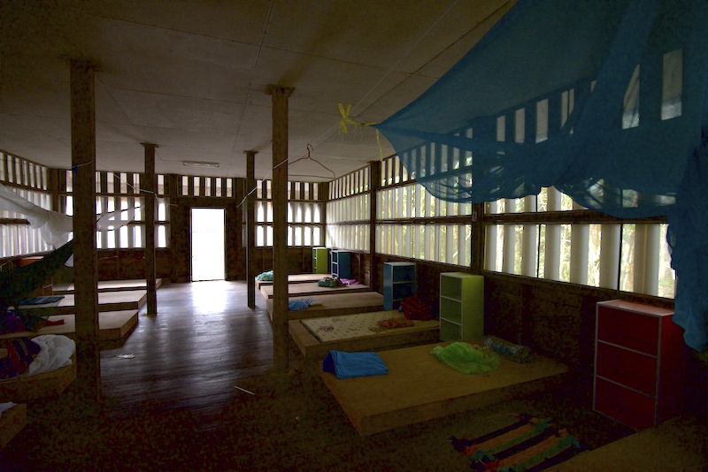 Men's dormitory - second floor - shows sleeping arrangements at Buddhist temple, Wat Suan Mokkh, in Southern Thailand's province of Chaiya.
