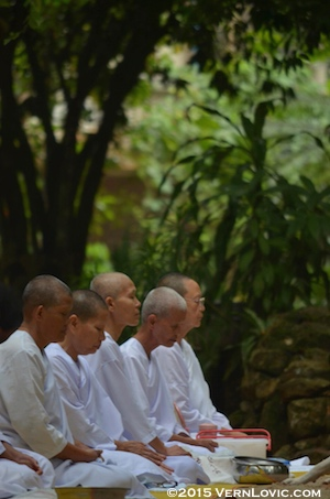 Shaved Buddhist nuns meditate in Thailand at Suan Mokkh temple in Chaiya, Southern Thailand.