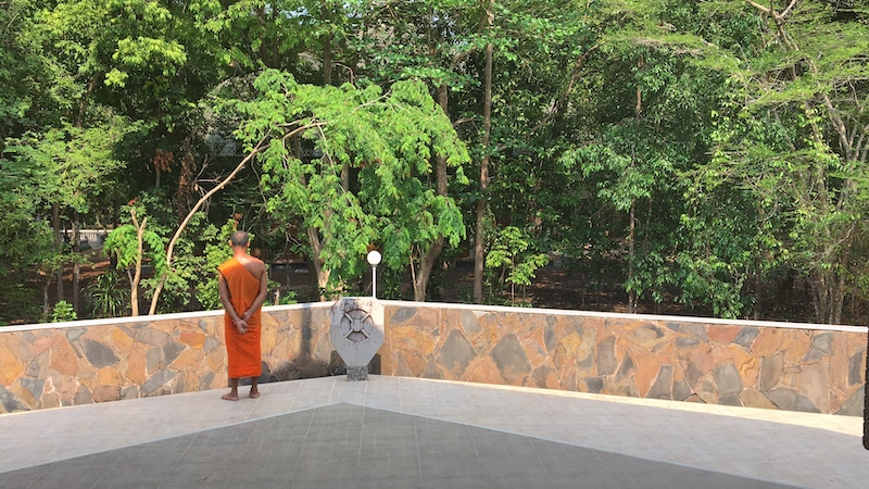 Theravada Buddhis monk at one of the open-air salas at Wat Nong Pah Pong forest temple in Warin Chamrap, Ubon province.