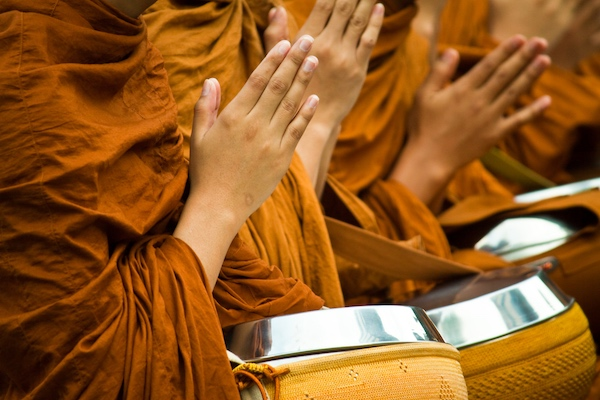 Monks chanting mantra at Buddhist temple.